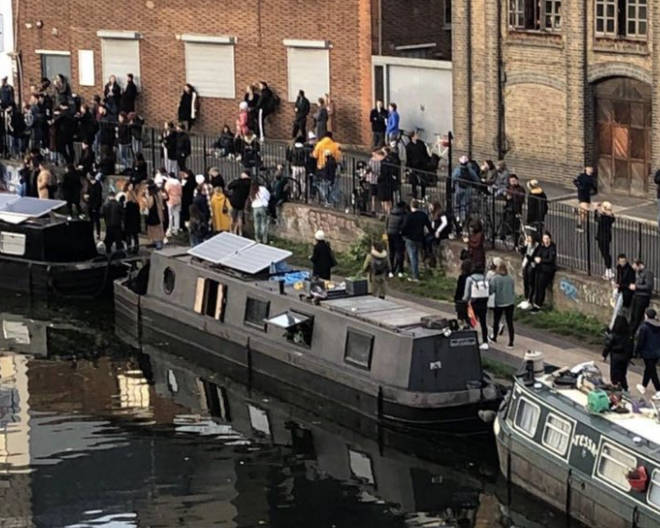 A large crowd near a canal in east London