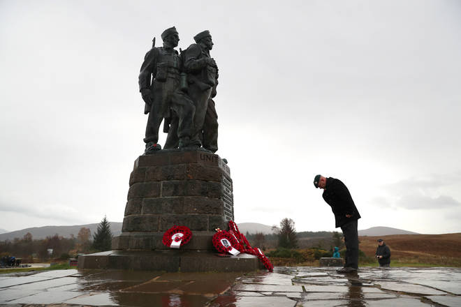 A small number of serving and former Royal Marine Commandos at the Commando Memorial at Spean Bridge, near Fort William, for the annual Remembrance Sunday ceremony.