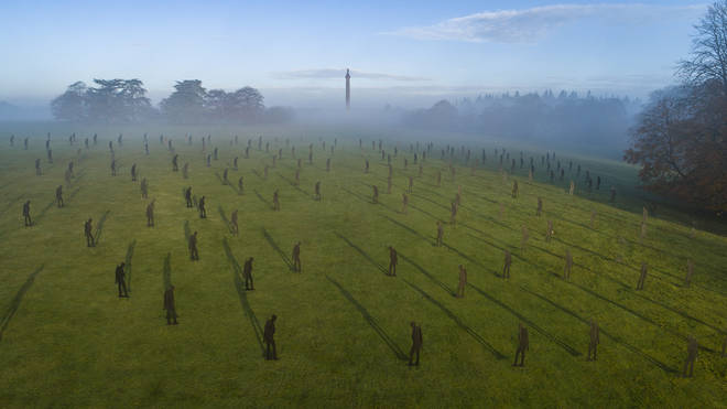 Aerial shot of silhouetted soliders at Blenheim Palace's Column of Victory as part of Remembrance celebrations