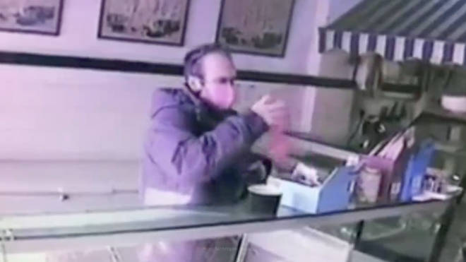 This is the moment the thief stole the poppy box from the counter of the butcher's shop