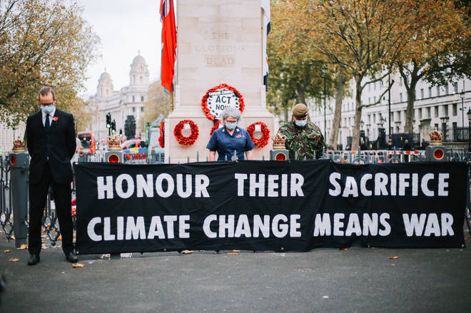 Extinction Rebellion have put a climate change banner on the Cenotaph on Remembrance Day