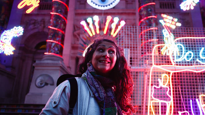 Passers by enjoy the art installation celebrating Diwali outside the Tate Britain gallery