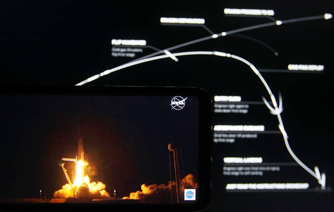 An Nasa illustration on the shows the SpaceX rocket's mission in stages