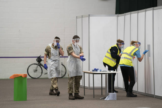 File photo: Members of the armed forces help to test the public at Liverpool Tennis Centre on the first day of the pilot scheme of mass testing in Liverpool
