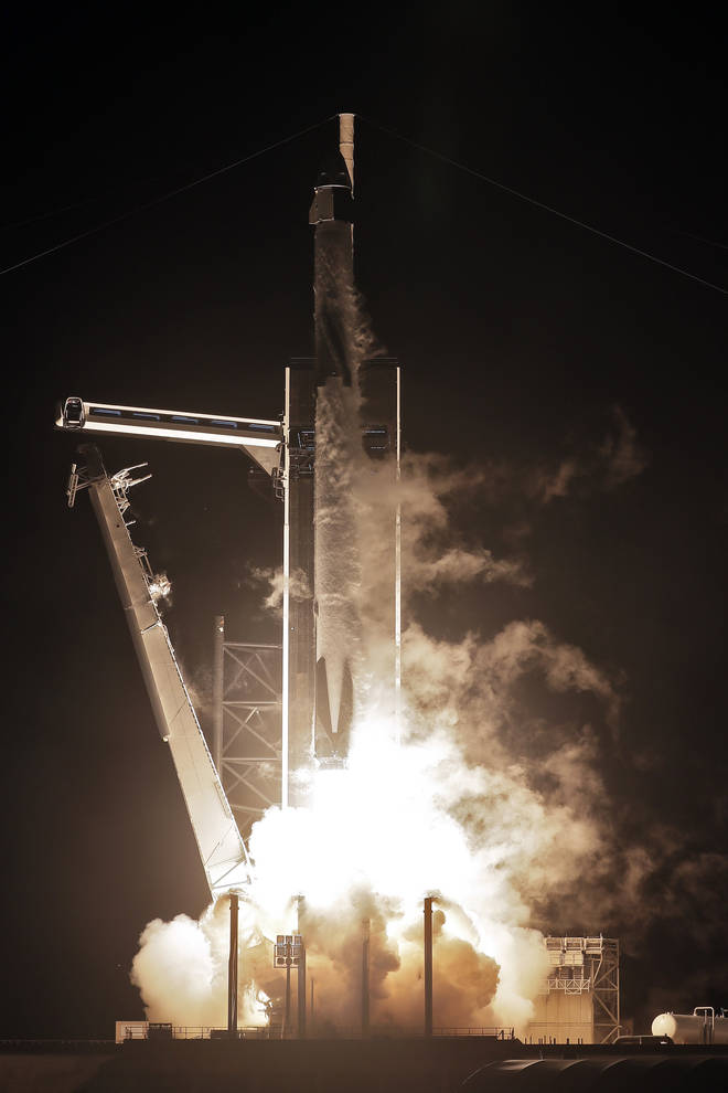 A SpaceX Falcon 9 rocket, with the Crew Dragon capsule attached, lifts off from Launch Complex 39-A on Sunday