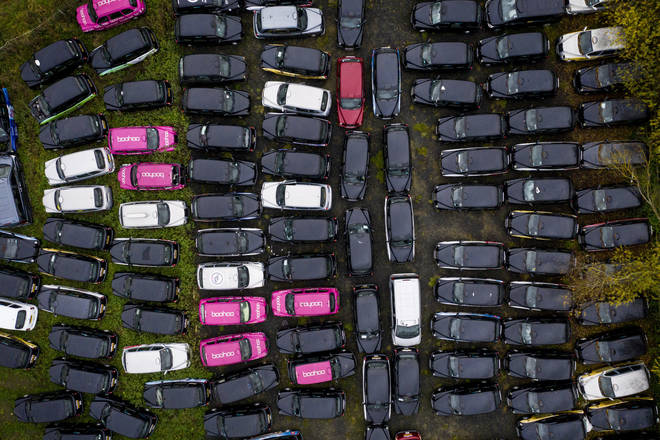 Fields and car parks are being hired by taxi firms to store cabs taken off the road
