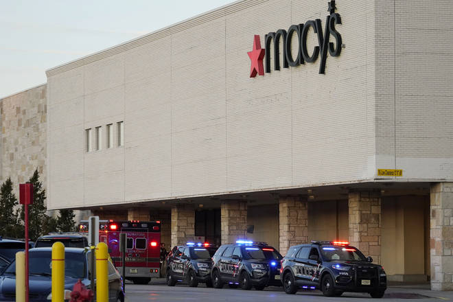 Police investigate a shooting at the Mayfair Mall