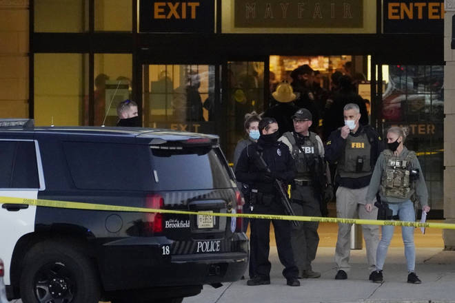 FBI officials and police stand outside the Mayfair Mall after a shooting