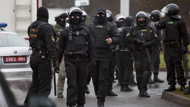 Belarusian riot police gather to block demonstrators