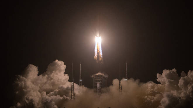A Long March-5 rocket, carrying the Chang'e-5 spacecraft, blasts off from the Wenchang Spacecraft Launch Site