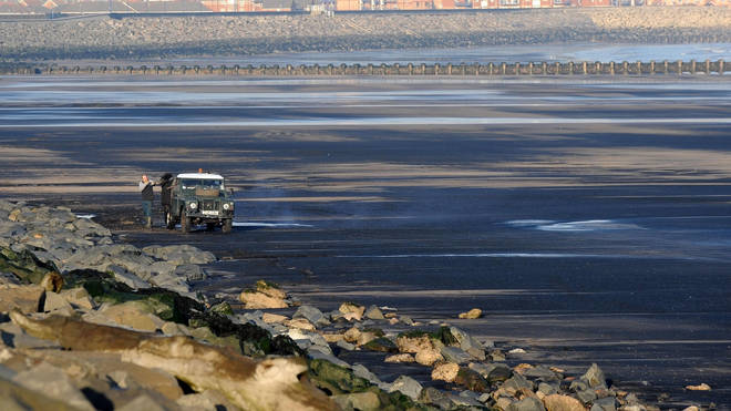 Coal on a beach (John Giles/PA)