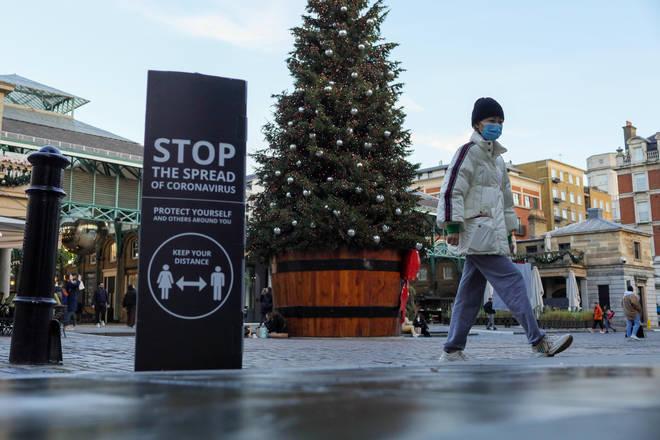 File photo: A person walks through Covent Garden, in London