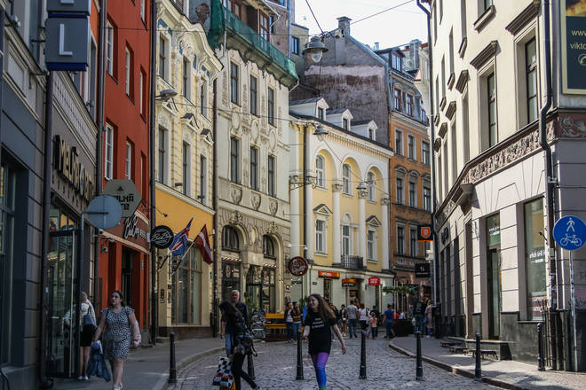 File photo: People walking by the old town street are seen in Riga, Latvia