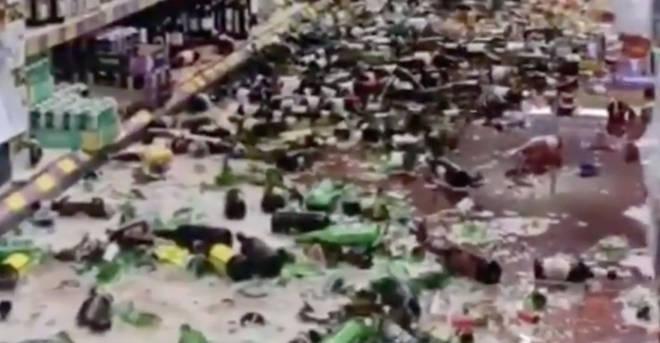 Bottles can be seen strewn across the floor as alcohol runs everywhere