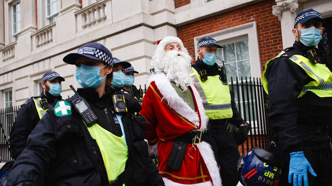 A protester dressed as Santa Claus was pictured in handcuffs during the demonstration