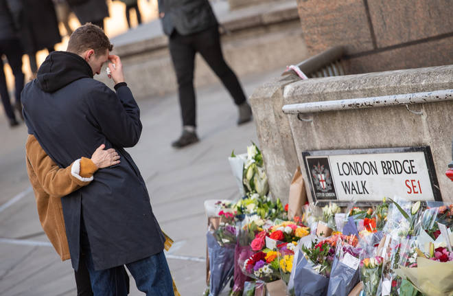 People lay flowers at the site of the tragedy