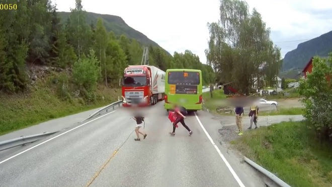 Child is almost hit by a lorry.