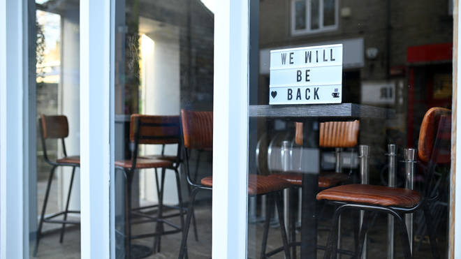 A sign in the window of a closed cafe reads 'We Will Be Back' as England enters a second lockdown