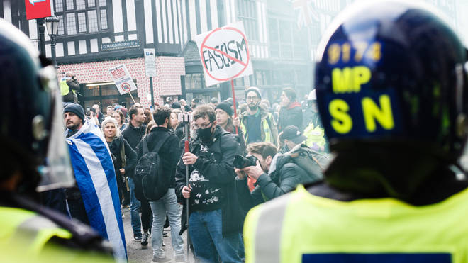 Police and protesters at an anti-lockdown protest in London