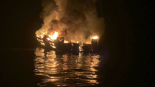 The dive boat Conception is engulfed in flames after a deadly fire broke out aboard the commercial scuba diving vessel off the Southern California Coast (Santa Barbara Fire Department/AP)