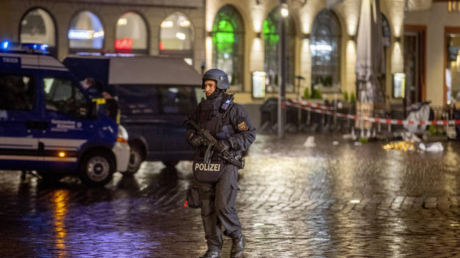 A police officer guards evidence at the scene of the incident in Trier, Germany (Michael Probst/AP)