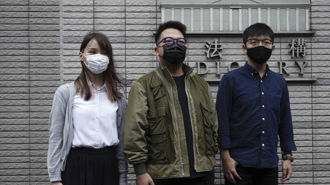 Hong Kong activists, from right, Joshua Wong, Ivan Lam and Agnes Chow (Vincent Yu/AP)