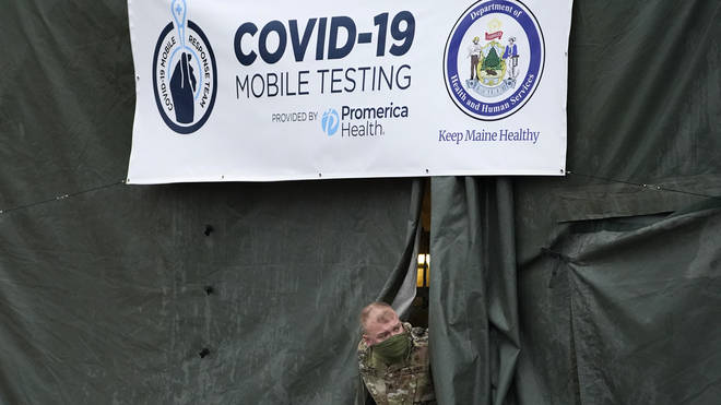 A member of the National Guard assisting at a Covid-19 mobile testing location in Auburn. Maine (Robert F. Bukaty/AP)