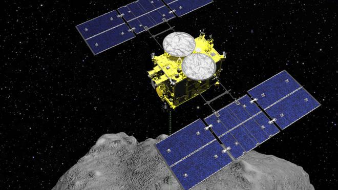 The Hayabusa2 spacecraft above the asteroid Ryugu