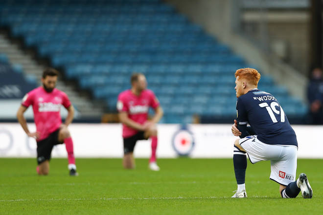 Millwall v Derby County fans booed as players took a knee