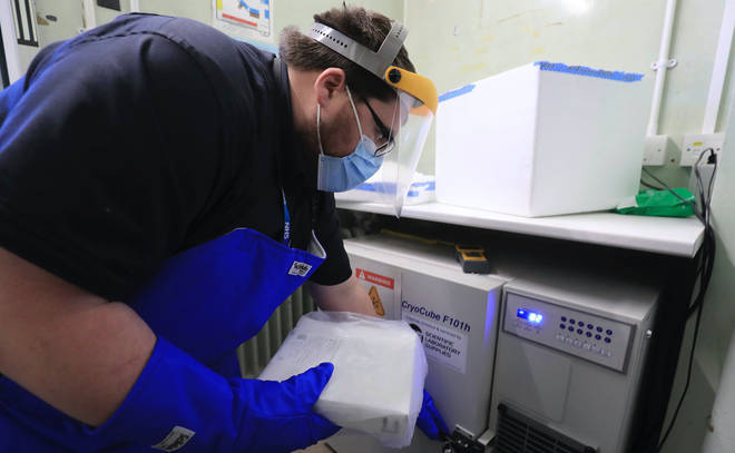 A pharmacy technician prepares to store the first delivery of Covid-19 vaccine at Croydon University Hospital