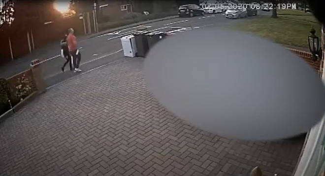 CCTV footage of Ms Smith and Mays walking home from a shop the day before her death