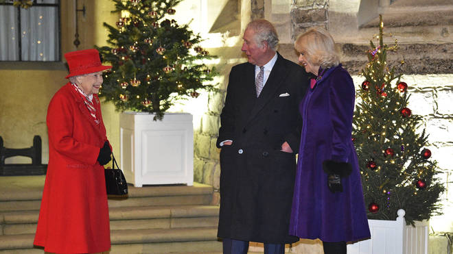 Queen Elizabeth II talks with Prince Charles and Camilla, Duchess of Cornwall
