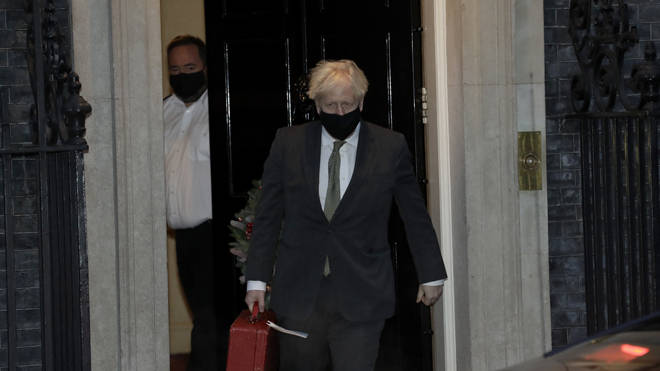 Boris Johnson pictured leaving for Brussels this evening