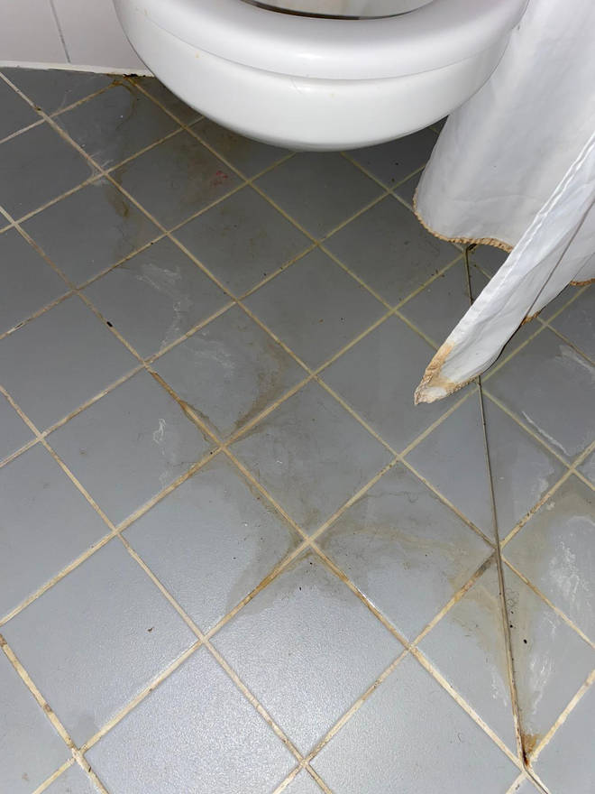 """Luke Sullivan from Goldsmiths says this was """"urine stained"""" bathroom floor of his £8,300 a year accommodation when he moved in."""