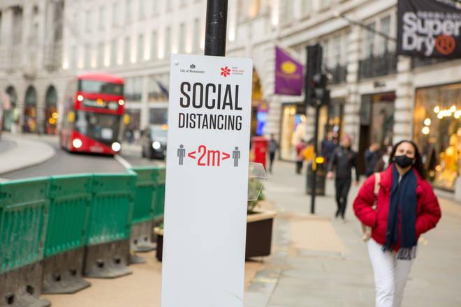 File photo: Social distancing sign on Regent St, London