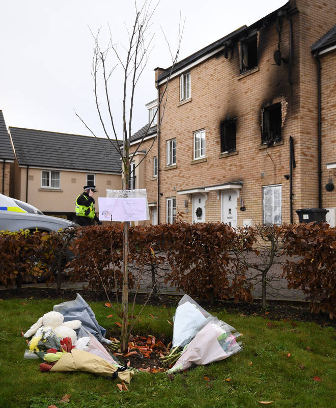 Tributes at the scene of a house fire on Buttercup Avenue, Eynesbury