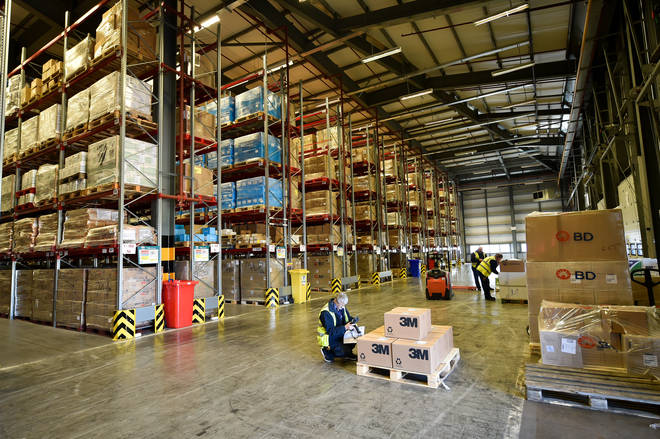File photo: A warehouse worker scans boxes of medical supplies, which are being stockpiled as part of Brexit preparations