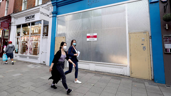 Boarded up shops on Islington High Street as the council announced the closure of all schools