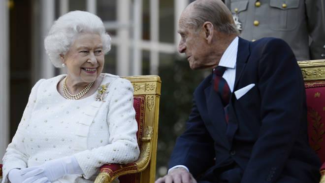 Queen Elizabeth II and the Duke of Edinburgh attending a garden party in Paris in 2014