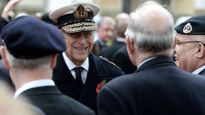 The Duke of Edinburgh meets veterans and servicemen during the opening of the Field of Remembrance at Westminster Abbey in 2015