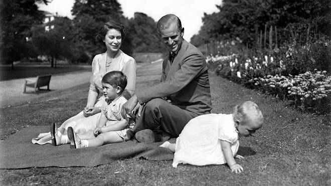 Princess Elizabeth, with the Duke of Edinburgh, and their two children, Prince Charles, and Princess Anne, in the grounds of Clarence House in 1951