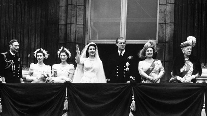 The royal wedding party appear on the balcony of Buckingham Palace after the wedding in 1947