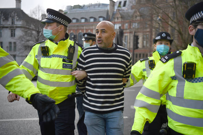 A man was seen being led away by police.