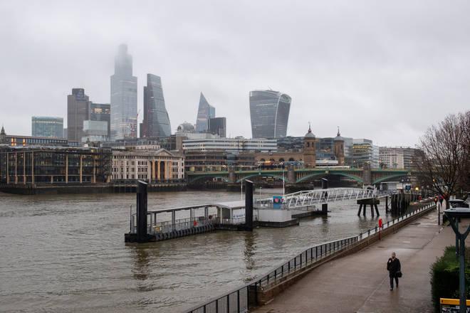 A man walks along London's South Bank