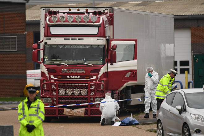 Police and forensic officers at the Waterglade Industrial Park in Grays, Essex, after 39 bodies of Vietnamese migrants were found inside the lorry