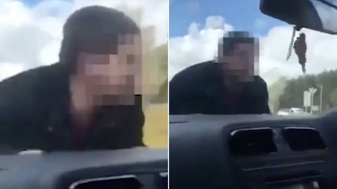 The man clings onto the car bonnet as the terrified driver screams