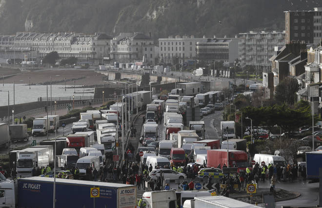 Vehicles wait at the entrance to the Port of Dover, that is blocked by police
