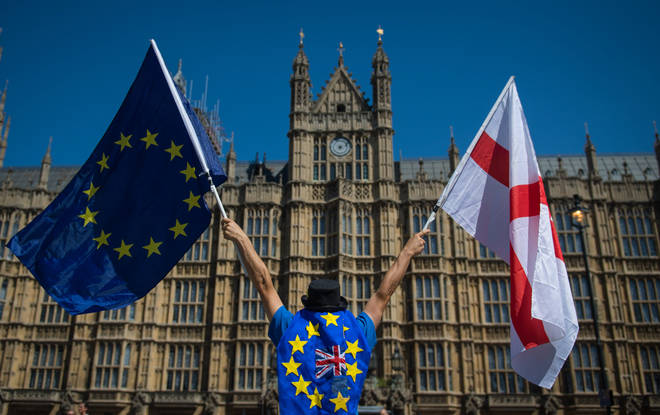 File photo: An anti-Brexit demonstrator holding European Union and England flags outside the Houses of Parliament