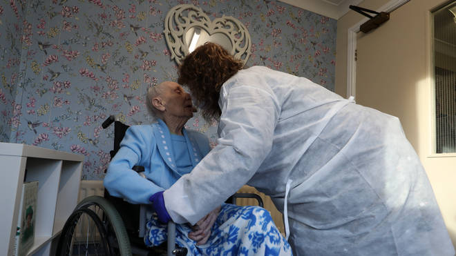 Diane Schofield embraces her friend Mary Kirby, who she affectionately calls Auntie Mary