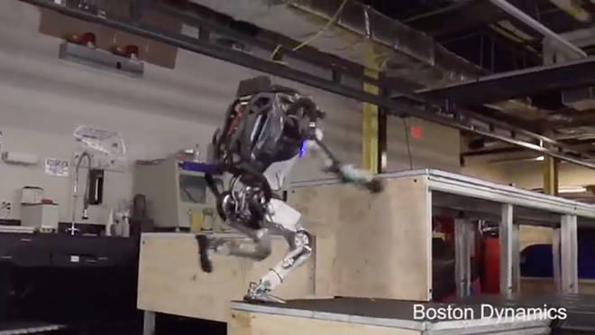 Atlas the robot jumps onto three blocks as it does a 'parkour'